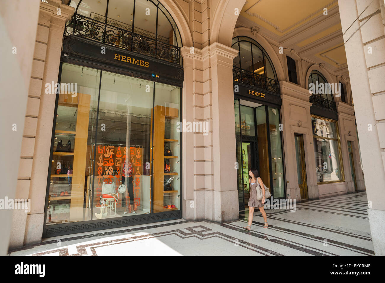 Turin shopping arcade, a woman walks through a portico in the luxury retail district of the Via Roma in Turin, Italy. - Stock Image