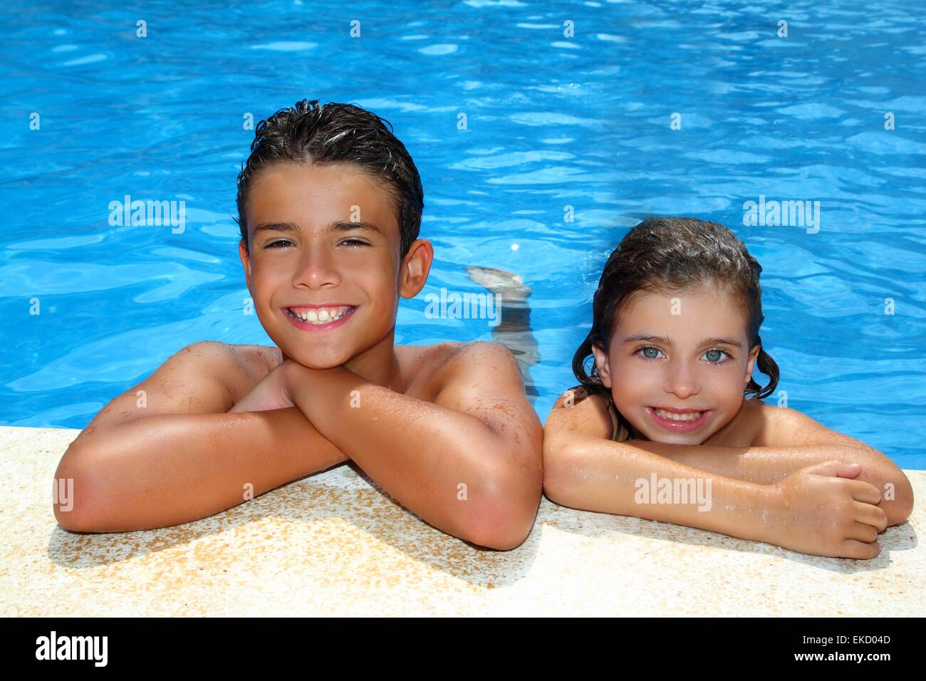 teen boy and little girl summer vacation in blue pool