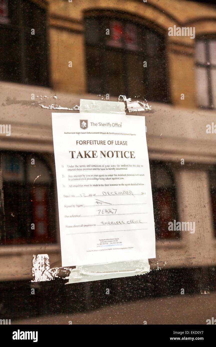 Take notice forfeit of lease foreclosure Sheriffs office warning letter display in window Norwich Norfolk UK England - Stock Image