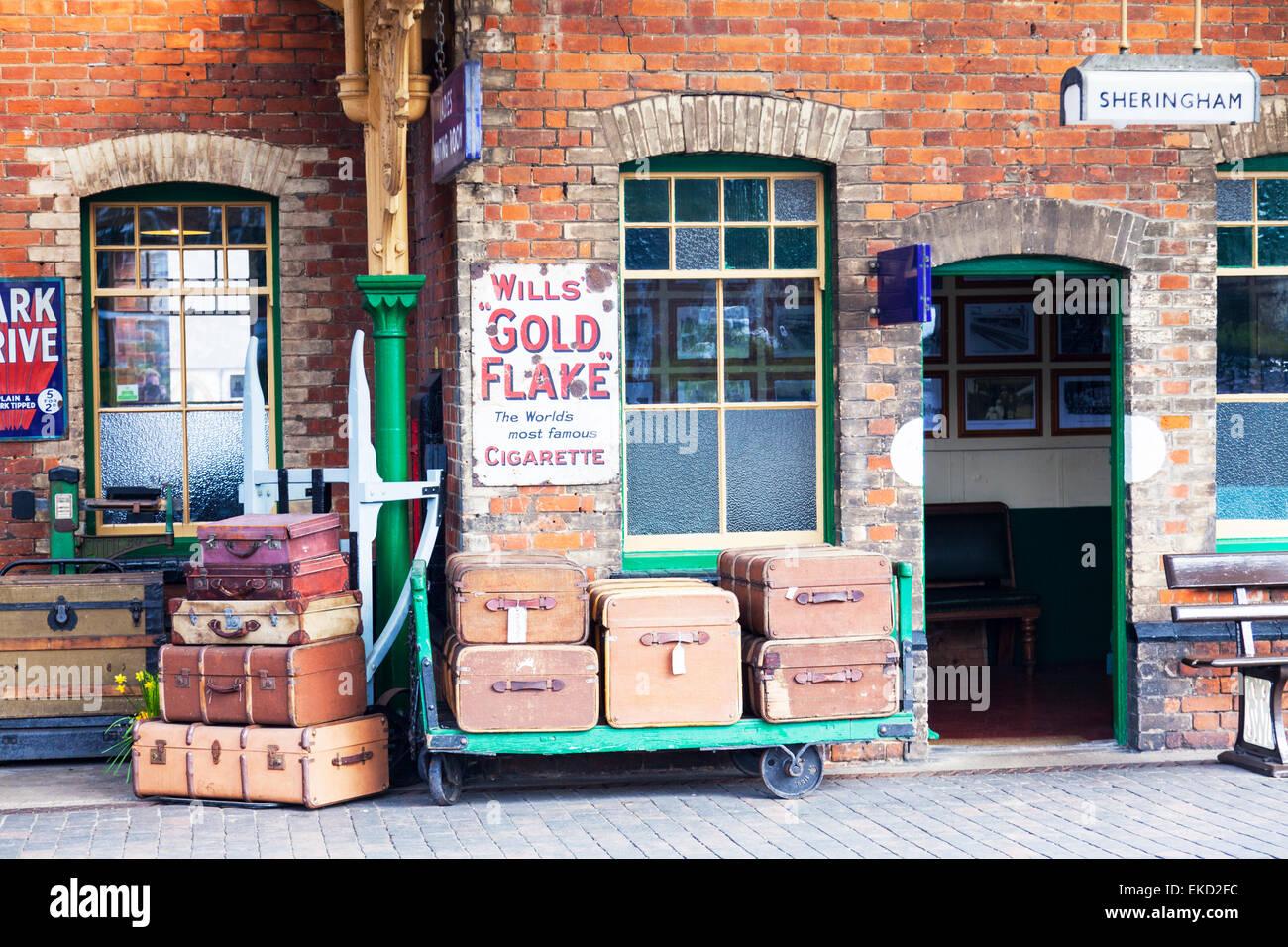 Luggage on yesteryear's, Sheringham railway station, North Norfolk, UK cases old platform travel trunks - Stock Image