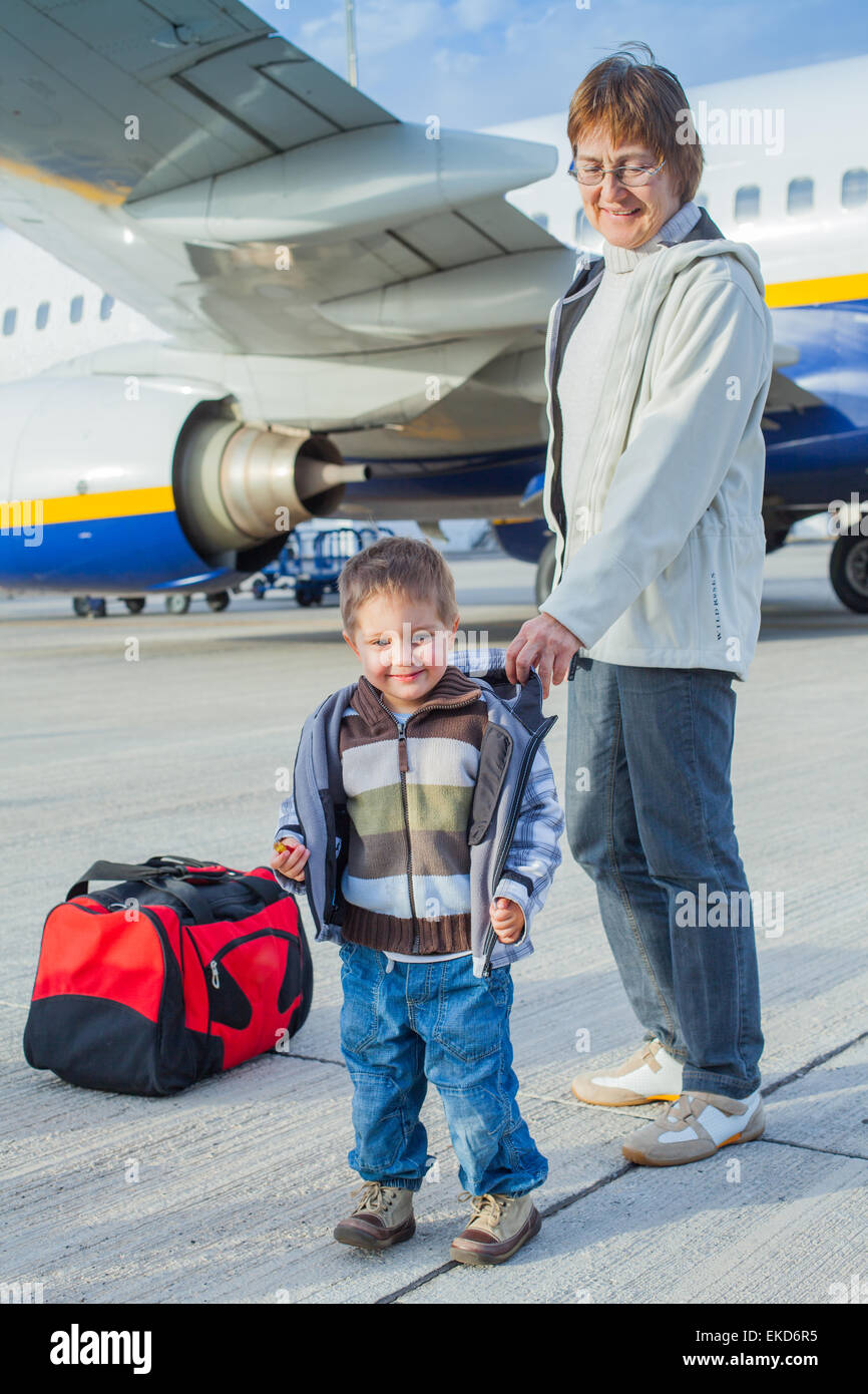cute boy and his grandmother prepared to fly - Stock Image