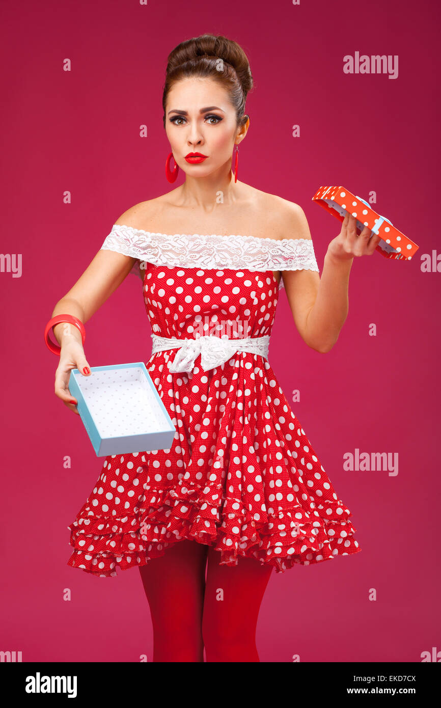 Gift disappointement. Pin-Up Retro Style Woman. - Stock Image