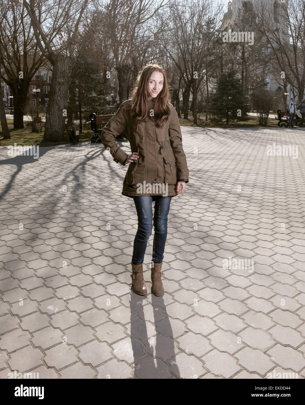 b48a79c97 Full body image of cute young women posing outdoors in city park smiling in  casual wear. A lot of copyspace on the pavement. Toned colorized stylized  film ...