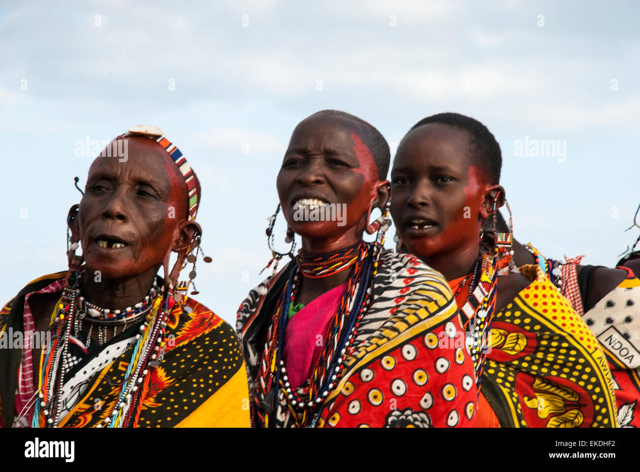 Three Masai women, missing teeth, one old, singing in a village near the Masai Mara, Kenya, East Africa. Stock Photo