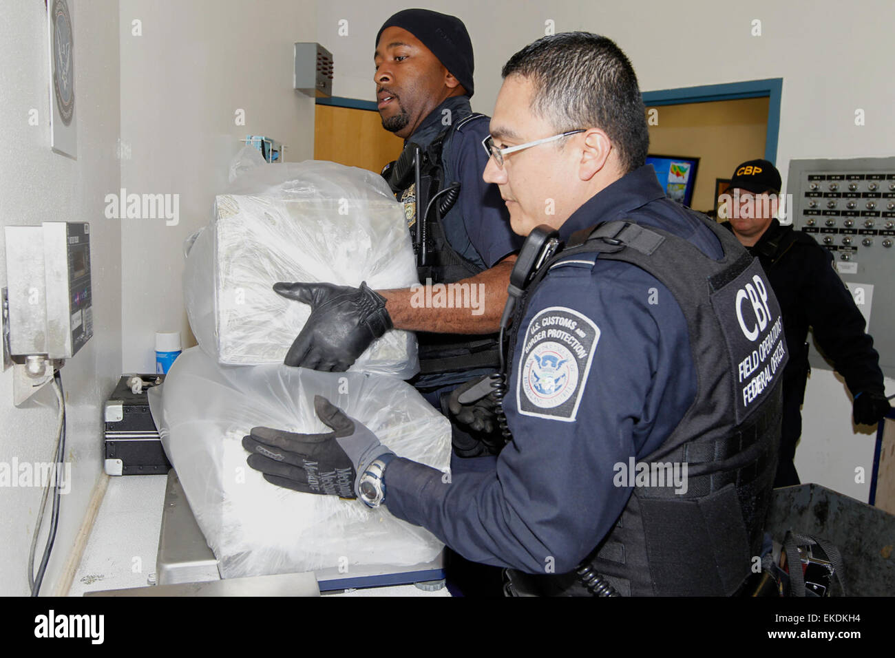 CBP field officer's drug seizure at DeConcini Nogales.  Field officers conduct an accurate weight of seized - Stock Image
