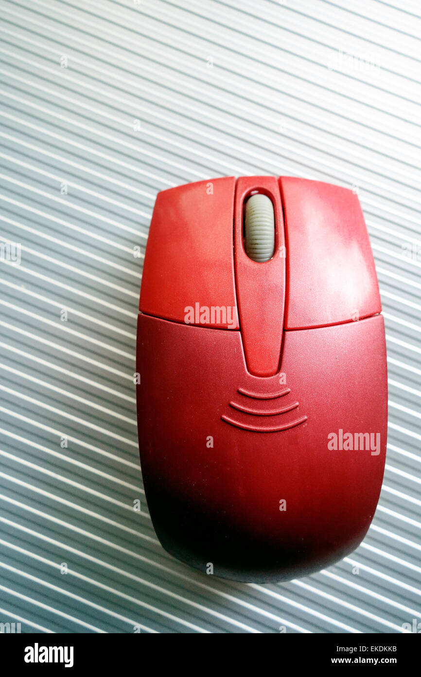Red Cordless Computer Mouse - Stock Image
