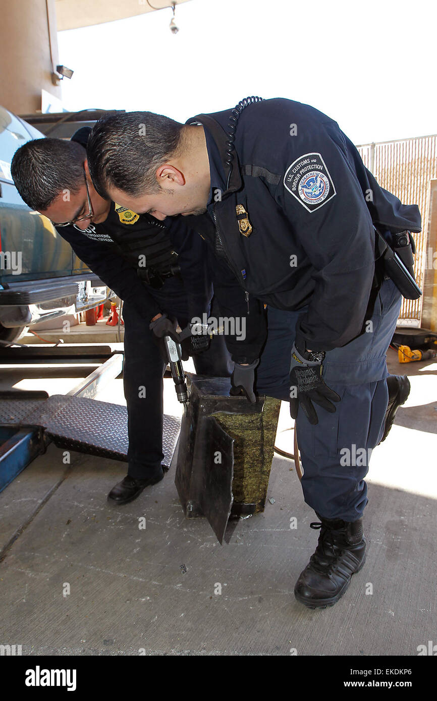CBP field officer's drug seizure at DeConcini Nogales port of entry.  Field officers cut drugs from metal.  - Stock Image