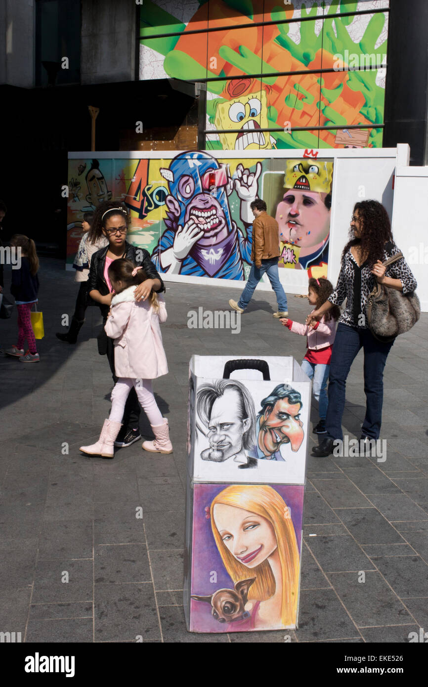 Street portrait caricatures and construction artwork faces in Leicester Square in central London. - Stock Image