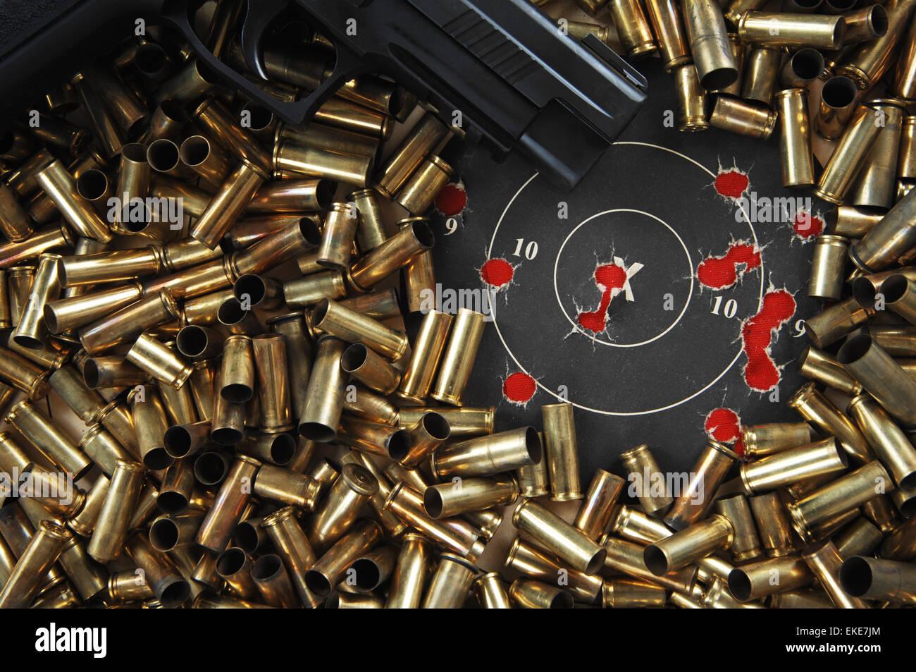 Target Practice, Pistol, Brass and paper target Stock Photo
