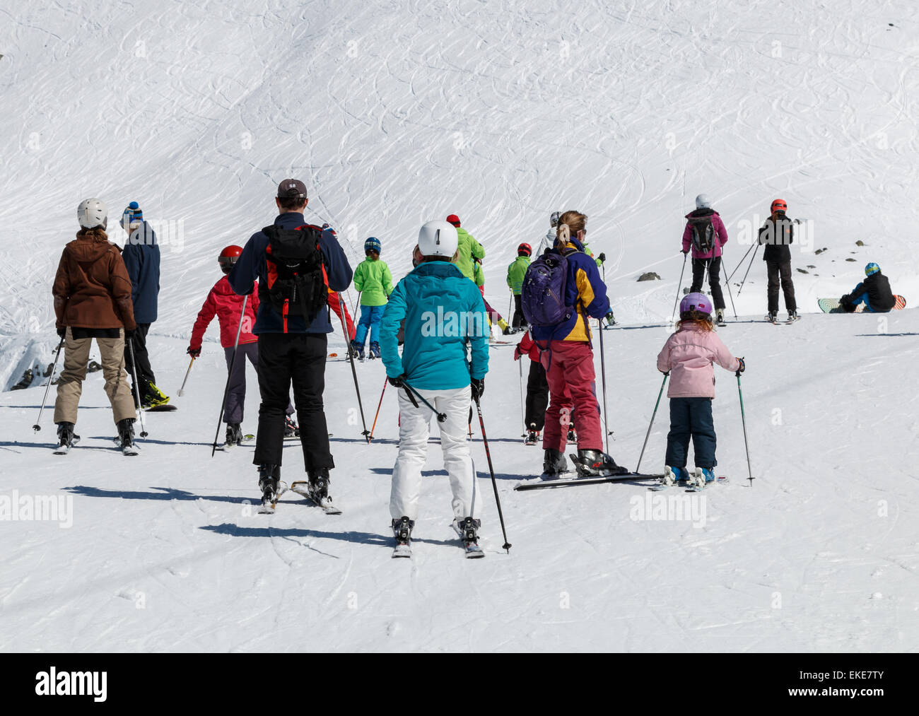 Group of skiers getting ready to descend a piste in the Swiss alps - Stock Image