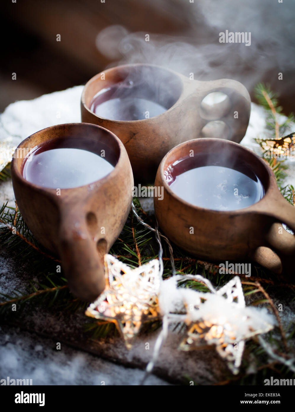 Mulled wine served from kuksa, specially made wooden cup Stock Photo
