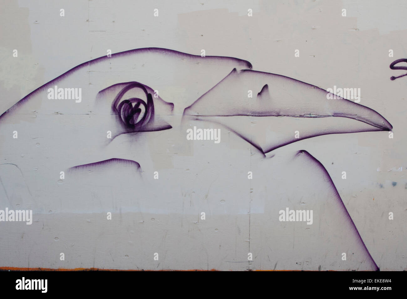 Graffiti of a bird on Broadway in Oakland at the 12th Street BART escalators. - Stock Image
