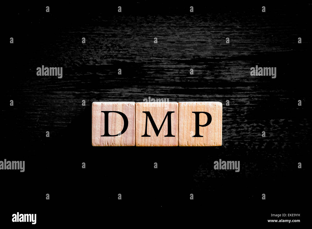 Acronym DMP- debt management plan. Wooden small cubes with letters isolated on black background with copy space - Stock Image