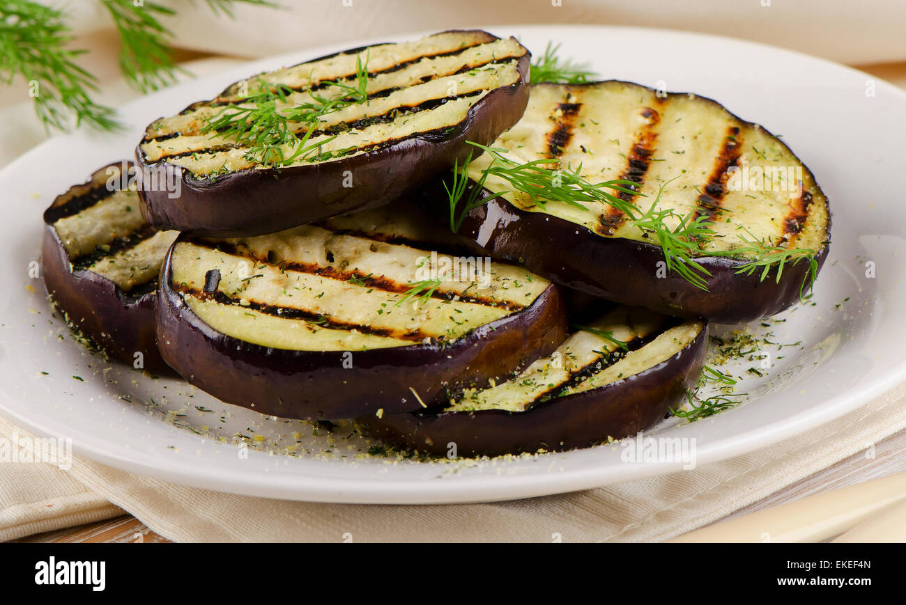 Grilled eggplant  on   plate. Selective focus - Stock Image