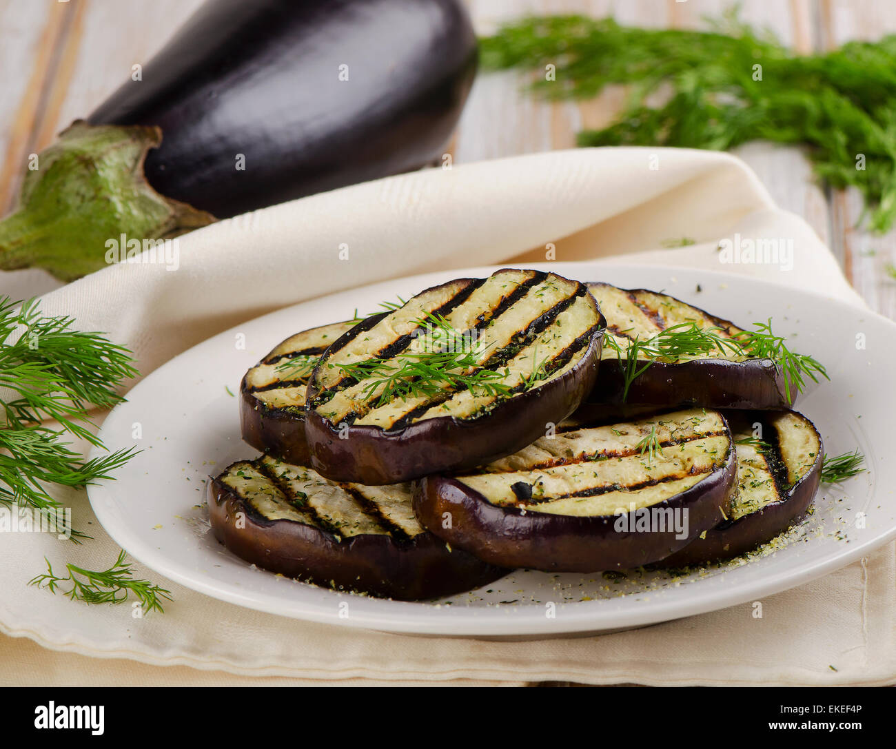Grilled eggplant  on a  plate. Selective focus - Stock Image