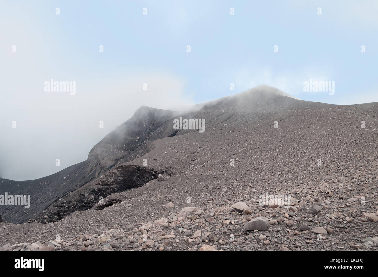 Volcano Merapi in the cloudsi. It is the most active volcano in Sumatra. Indonesia - Stock Image