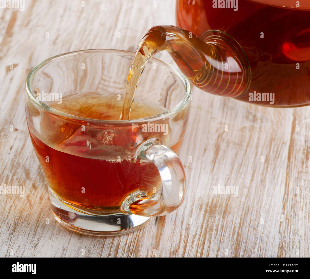 Tea pouring into glass cup. Selective focus - Stock Image