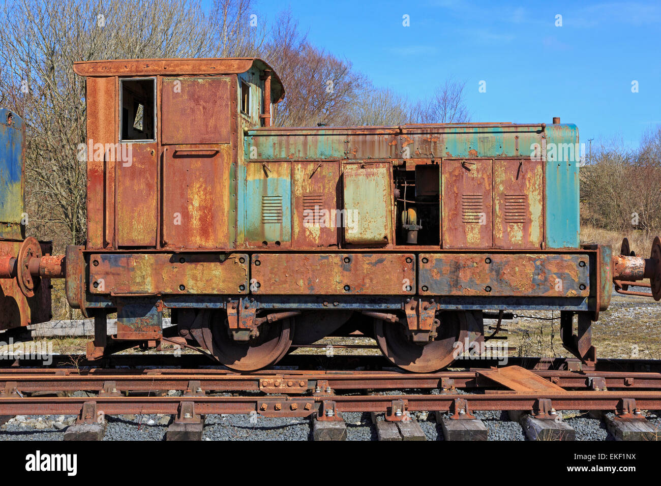 Rusting, disused and abandoned industrial traction train parked on a siding, Ayrshire, Scotland, UK - Stock Image