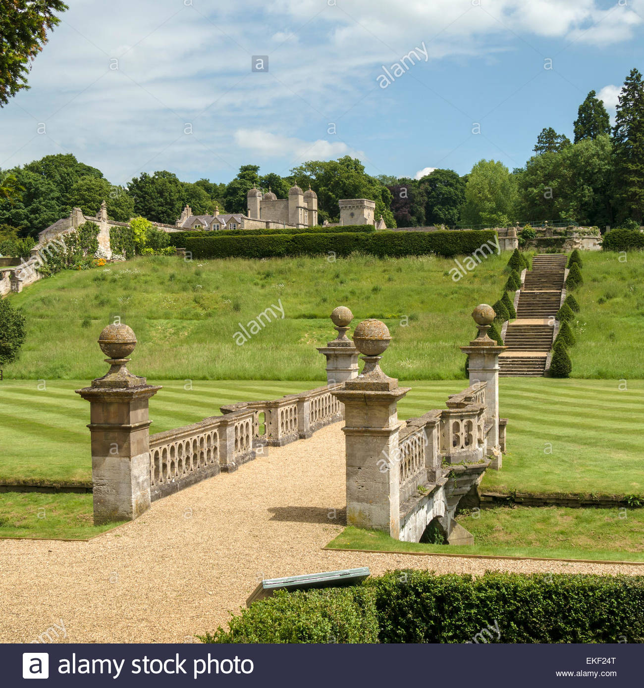 Bridge over River Witham and landscaped gardens, Easton Walled Gardens, Grantham, Lincolnshire, England, UK. - Stock Image