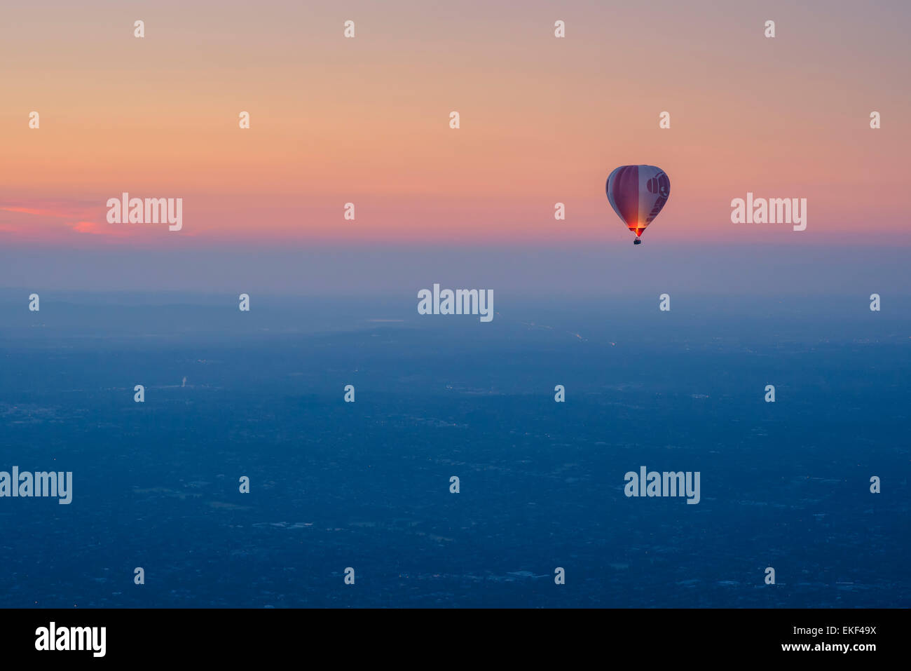 Tourists enjoy hot air balloon flights at sunrise over Melbourne, Australia. Stock Photo