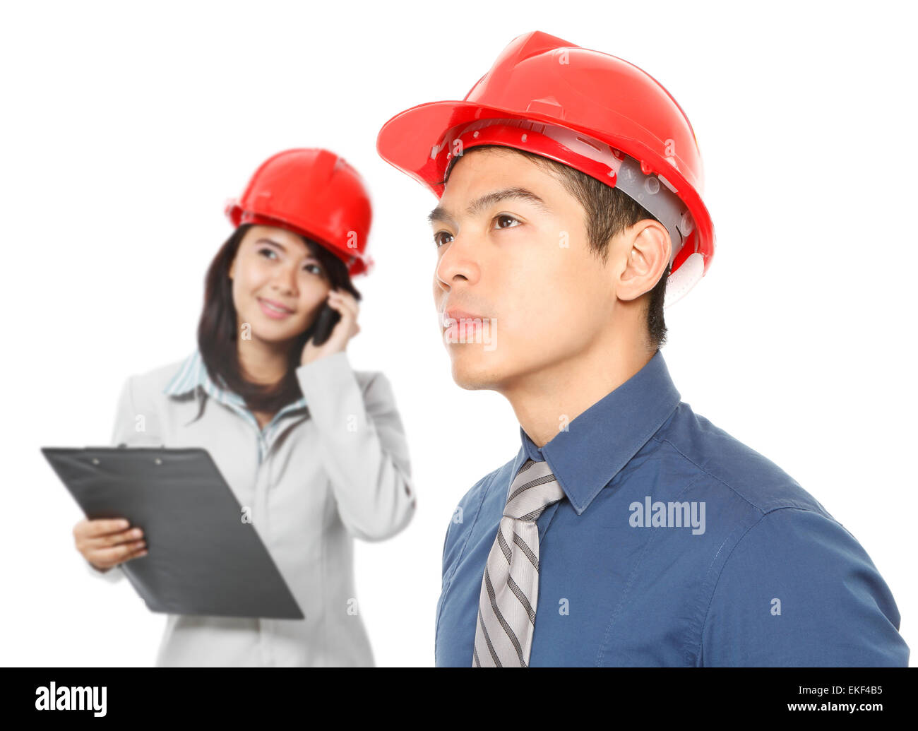 Young Professionals Looking Up - Stock Image