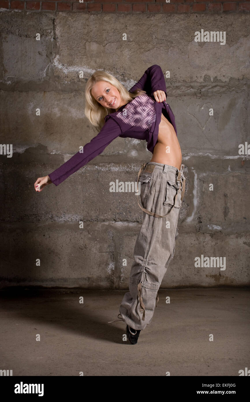 Beautiful Hip Hop Girl Dancing Over Grey Brick Wall Stock Photo Alamy