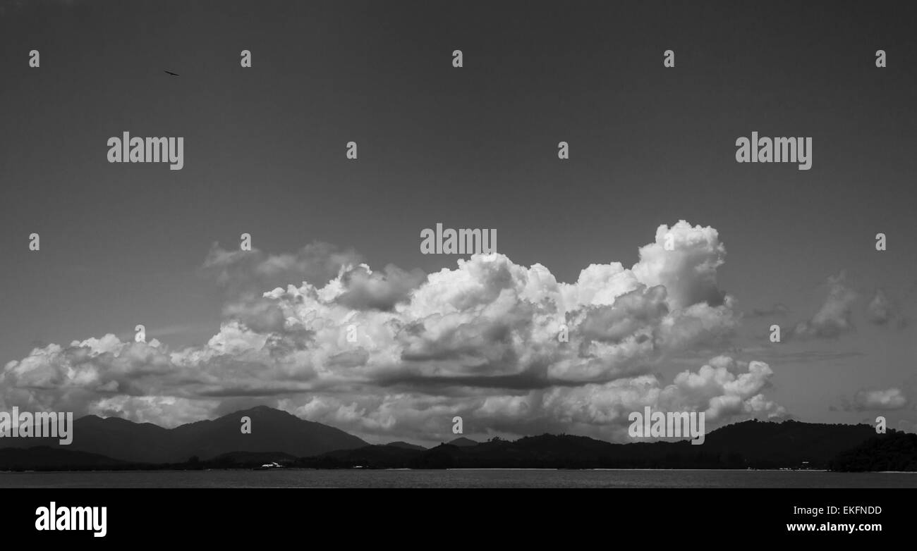 Clouds hovering the mountains. - Stock Image