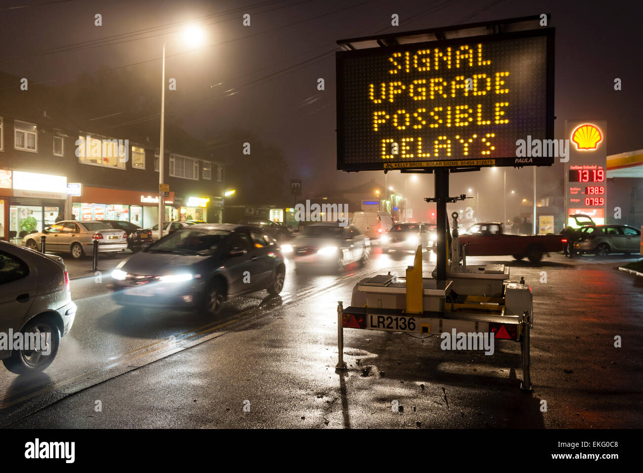Sign warning of traffic delays at night - Stock Image