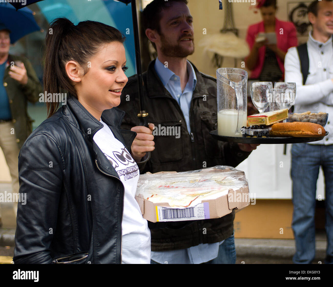 An event near Borough Market on Bastille Day is a race for waiters and waitresses carrying trays of food and wine. - Stock Image