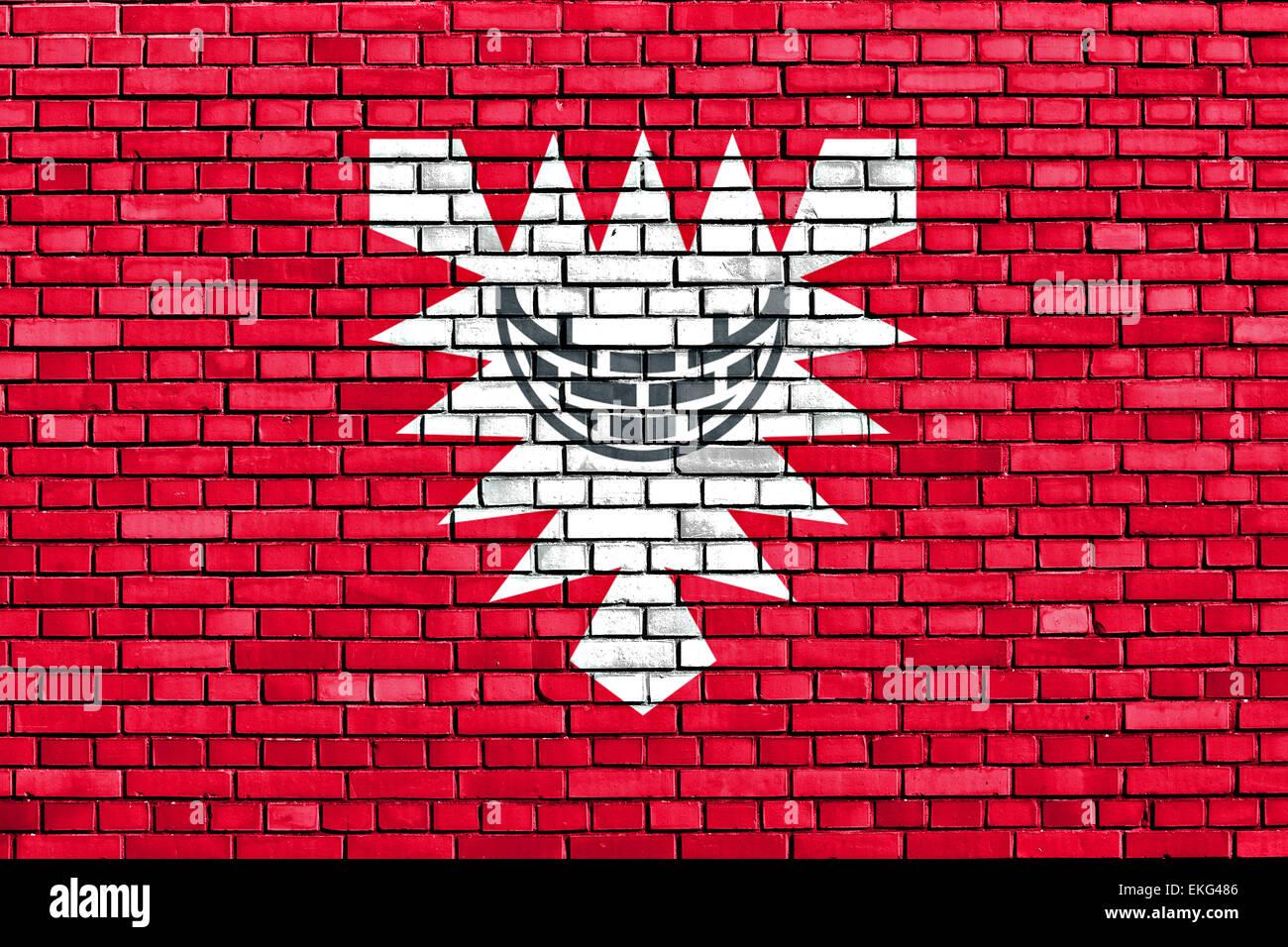 flag of Kiel painted on brick wall - Stock Image