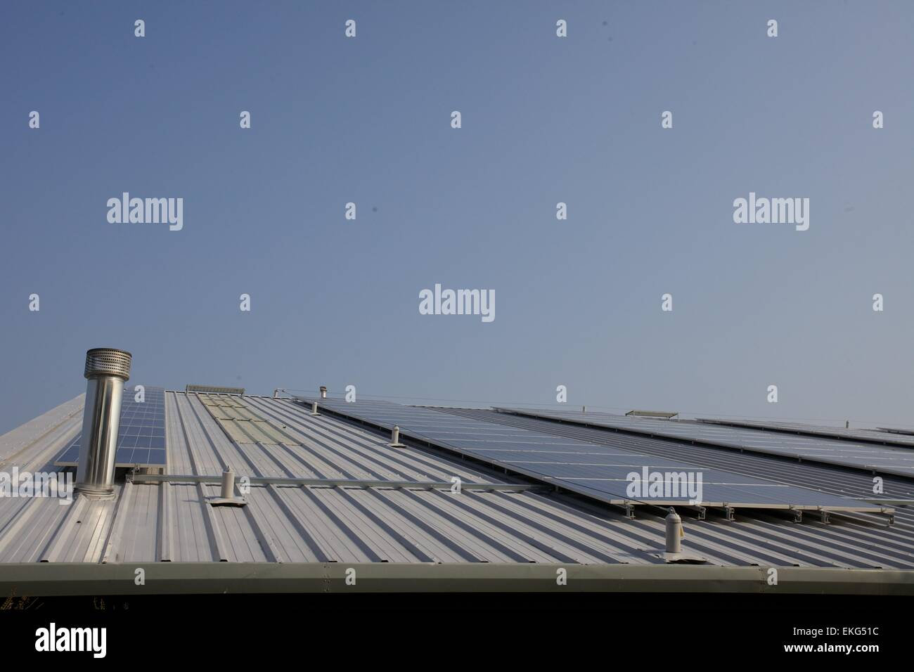 Galvanized roof with solar panels - Stock Image