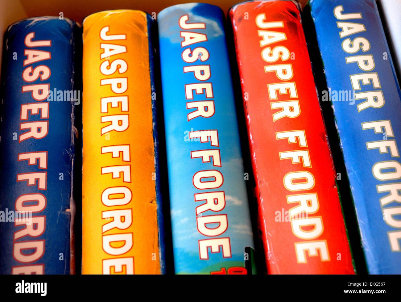 Hardback Jasper Fforde books on a bookshelf - Stock Image