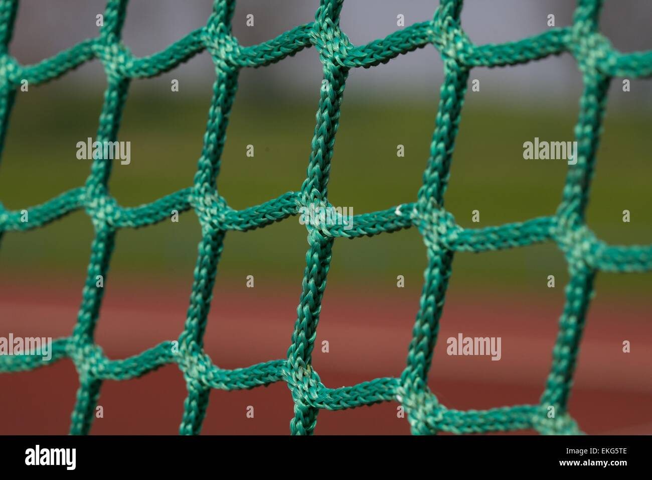close up shot of green netting on a sports field - Stock Image