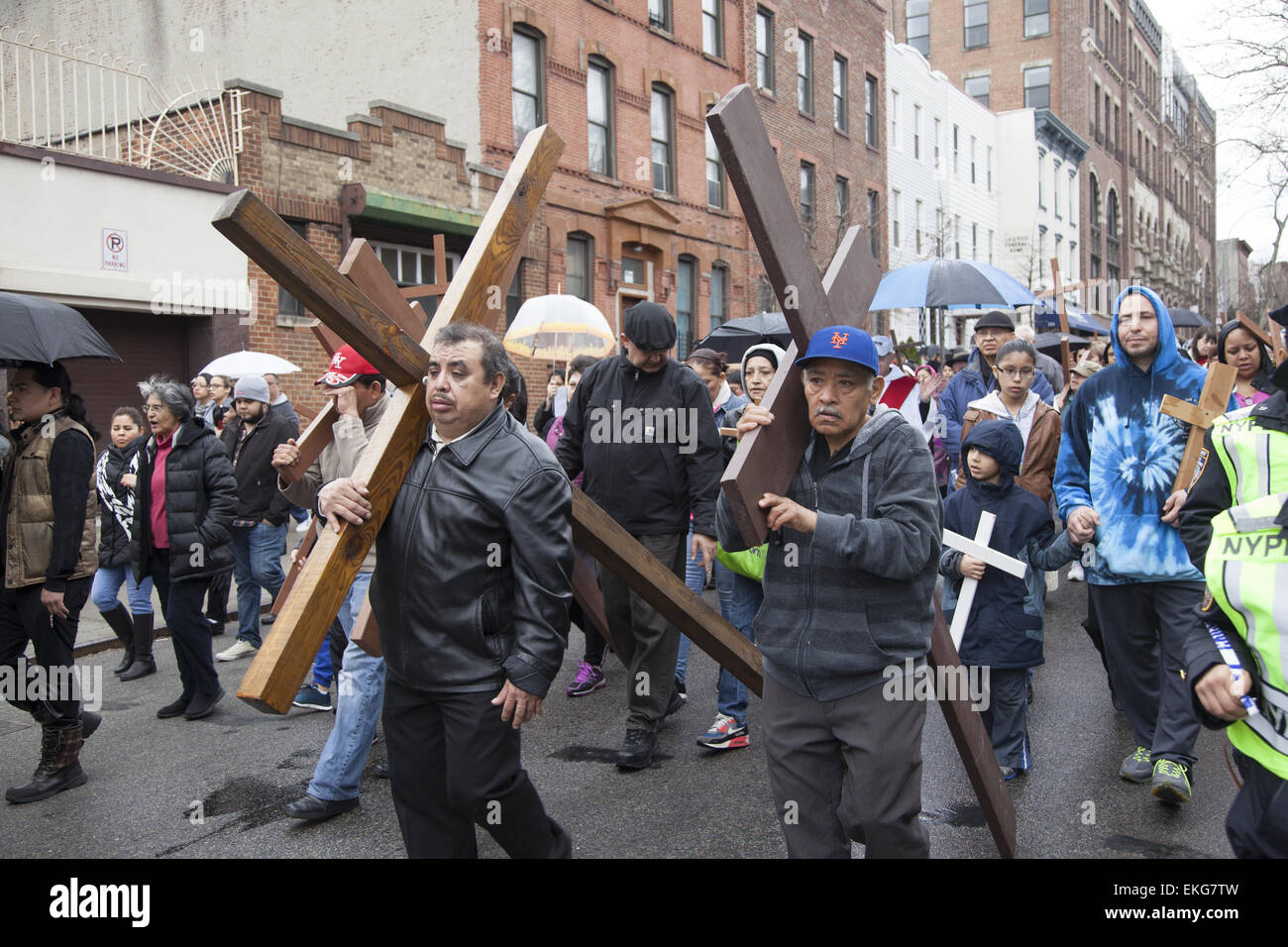 Good Friday procession of The Stations Of The Cross recited in English, Spanish & Polish in Park Slope, Brooklyn, - Stock Image