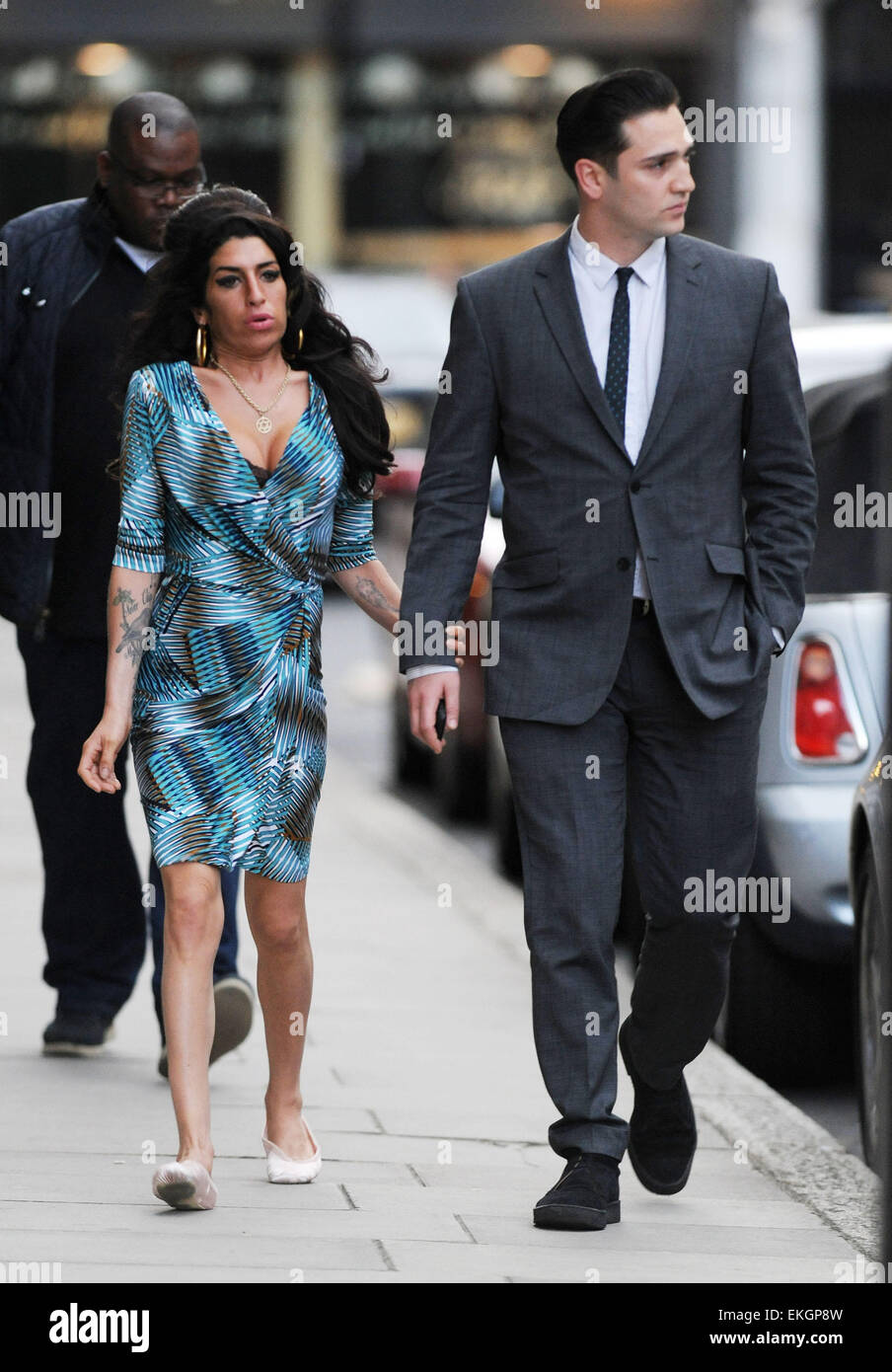 Amy Winehouse Proves Once And For All That Her Marriage To Blake Fielder Civil Is Finally Over As Her And Her New Man British Film Director Reg Traviss Step Out For The First