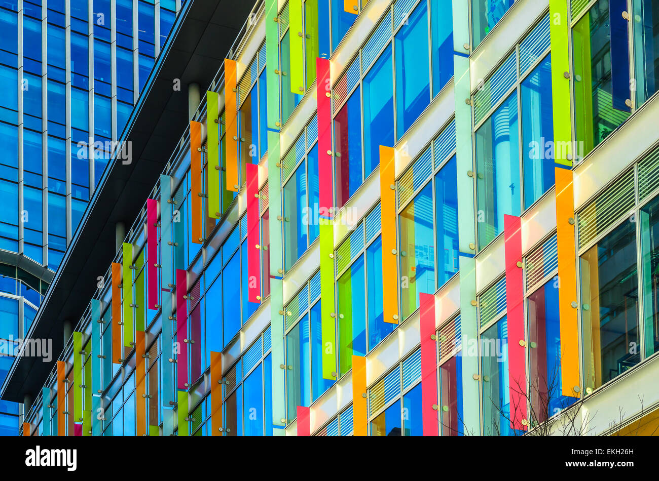 Modern building with multi-colored windows and design panels attached, in Amsterdam, Netherlands, horizontal position. - Stock Image