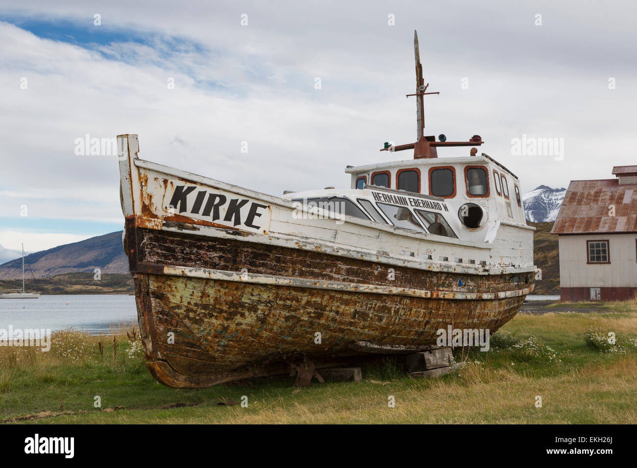 Old wooden boat hauled up out of the water, Puerto Consuelo, Chile Stock Photo