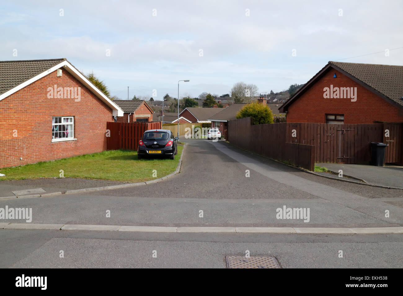 cul-de-sac in a residential housing estate of bungalows in the uk - Stock Image
