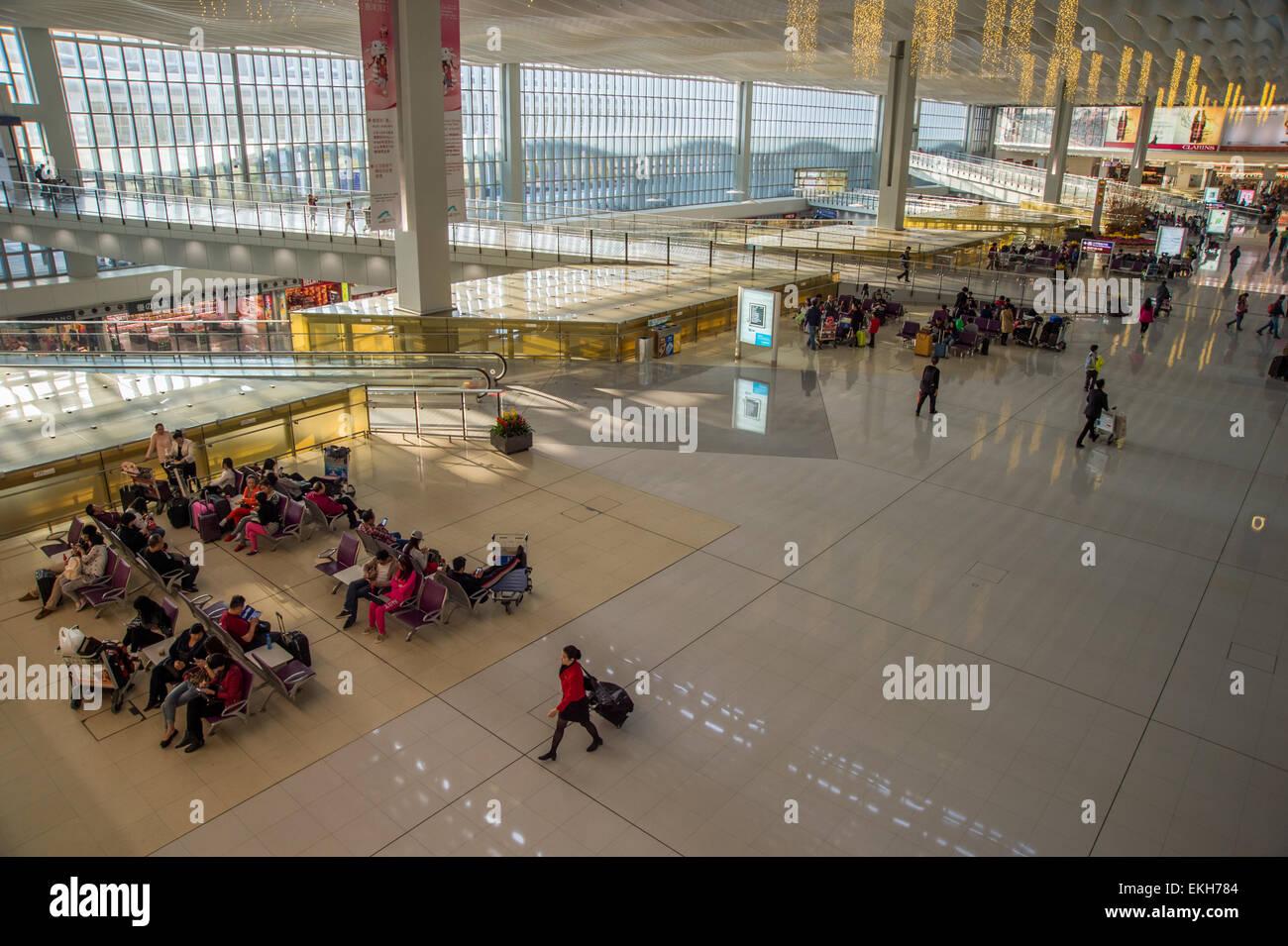 Passengers waiting for their flights at Hong-Kong Airport Stock Photo