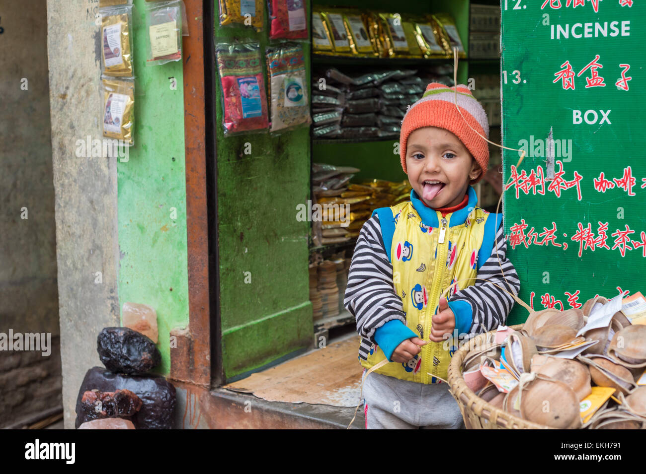 Nepali boy in front of an incense shop in Kathmandu - Stock Image
