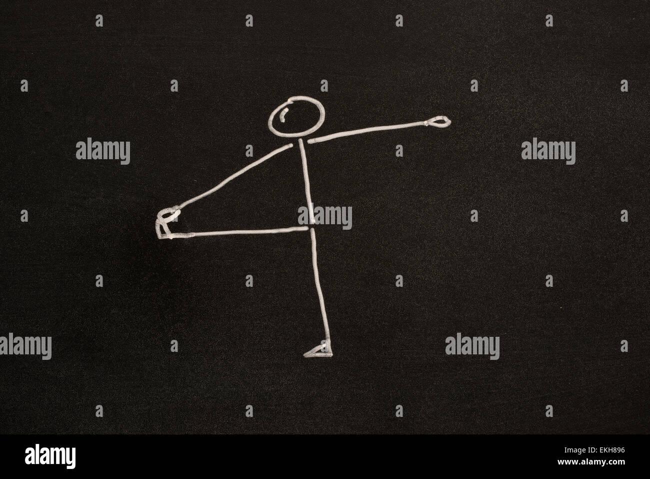Hand To Toe Balancing Pose - Utthita Padangusthasana on blackboard on blackboard - Stock Image