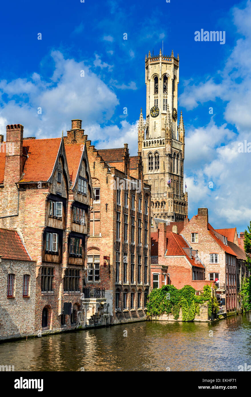 Bruges, Belgium. Image with Belfort (Belfry) tower and Rozenhoedkaai famous place in Brugge. Dijver river canal - Stock Image