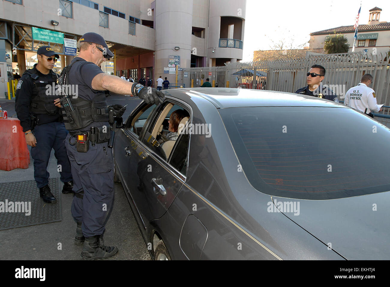 Nogales, AZ - U.S. Customs & Border Protection Officers monitor and inspect vehicles crossing out of  the - Stock Image