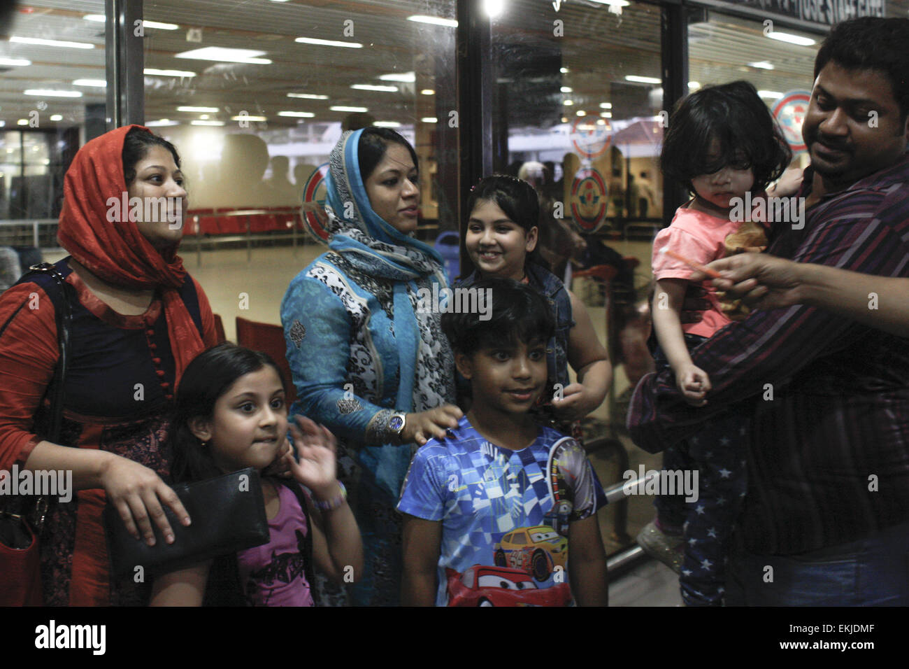 Dhaka, Bangladesh. 10th Apr, 2015. Bangladeshi woman Elora Zahan (left) along with her two child were returned Bangladesh - Stock Image