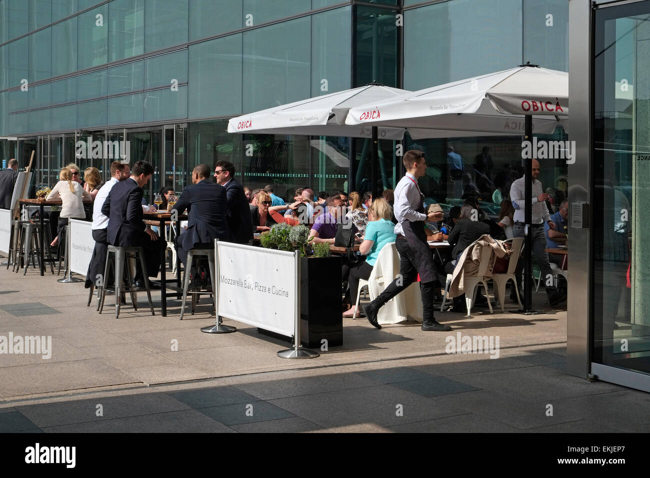 office workers on lunch break, canary wharf, london, england Stock Photo
