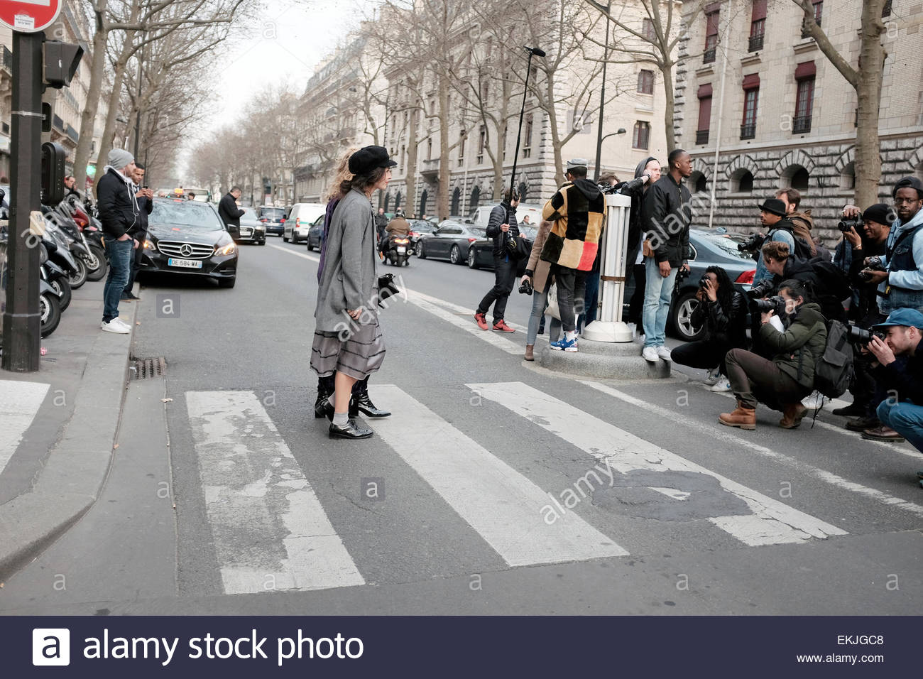 StreetStyle Photographers photographing arrivals for Hermès,  RTW Fall-Winter  PFW. On Boulevard Henri IV. - Stock Image