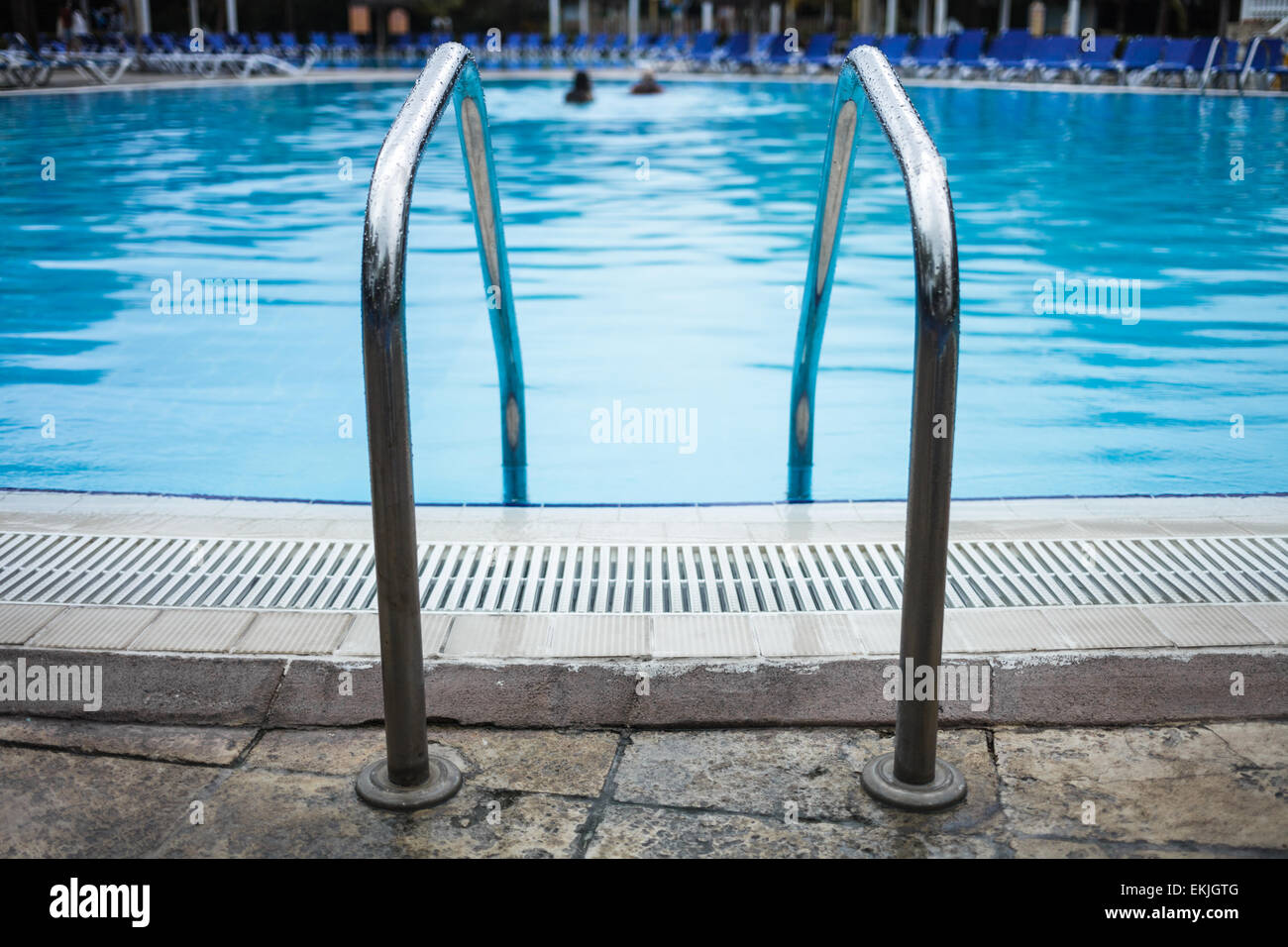 swimming pool background. Swimming Pool Ladder Close-up With Blurry People In Background - Stock Image Swimming Pool G