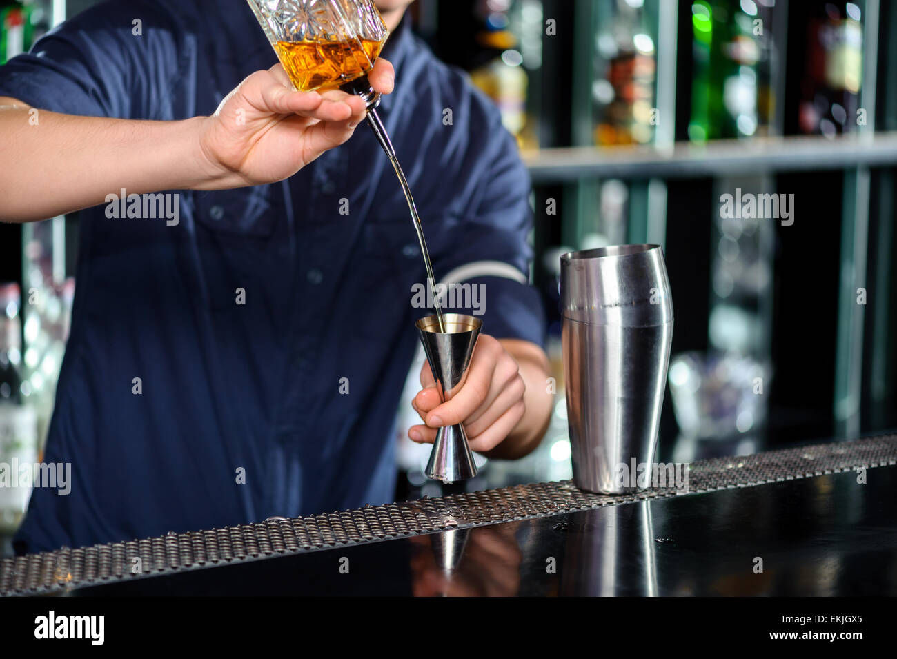 Barman makes cocktail on the counter - Stock Image