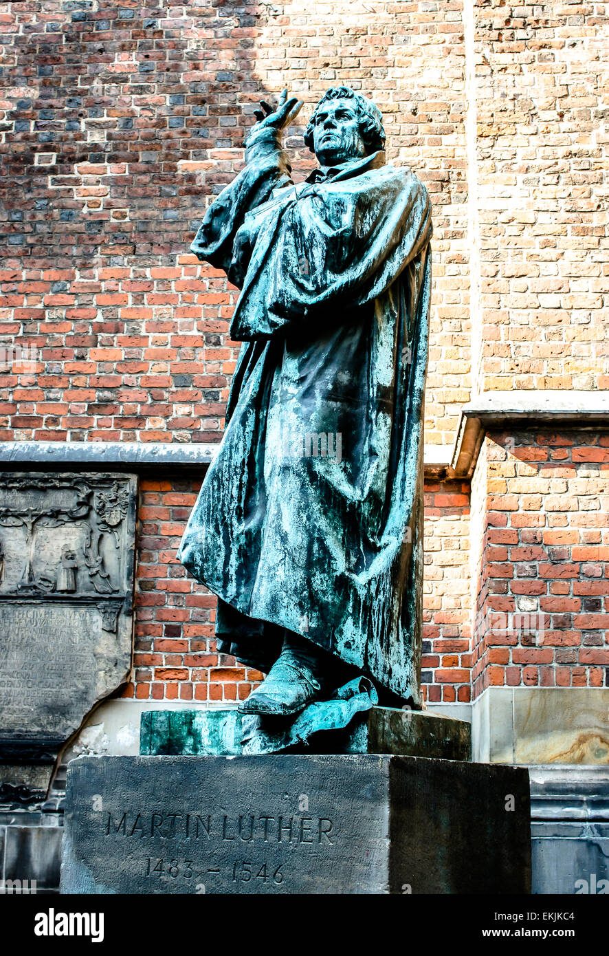 A large statue of religious reformer Martin Luther in Hannover, Germany outside the historic Marktkirche church. - Stock Image