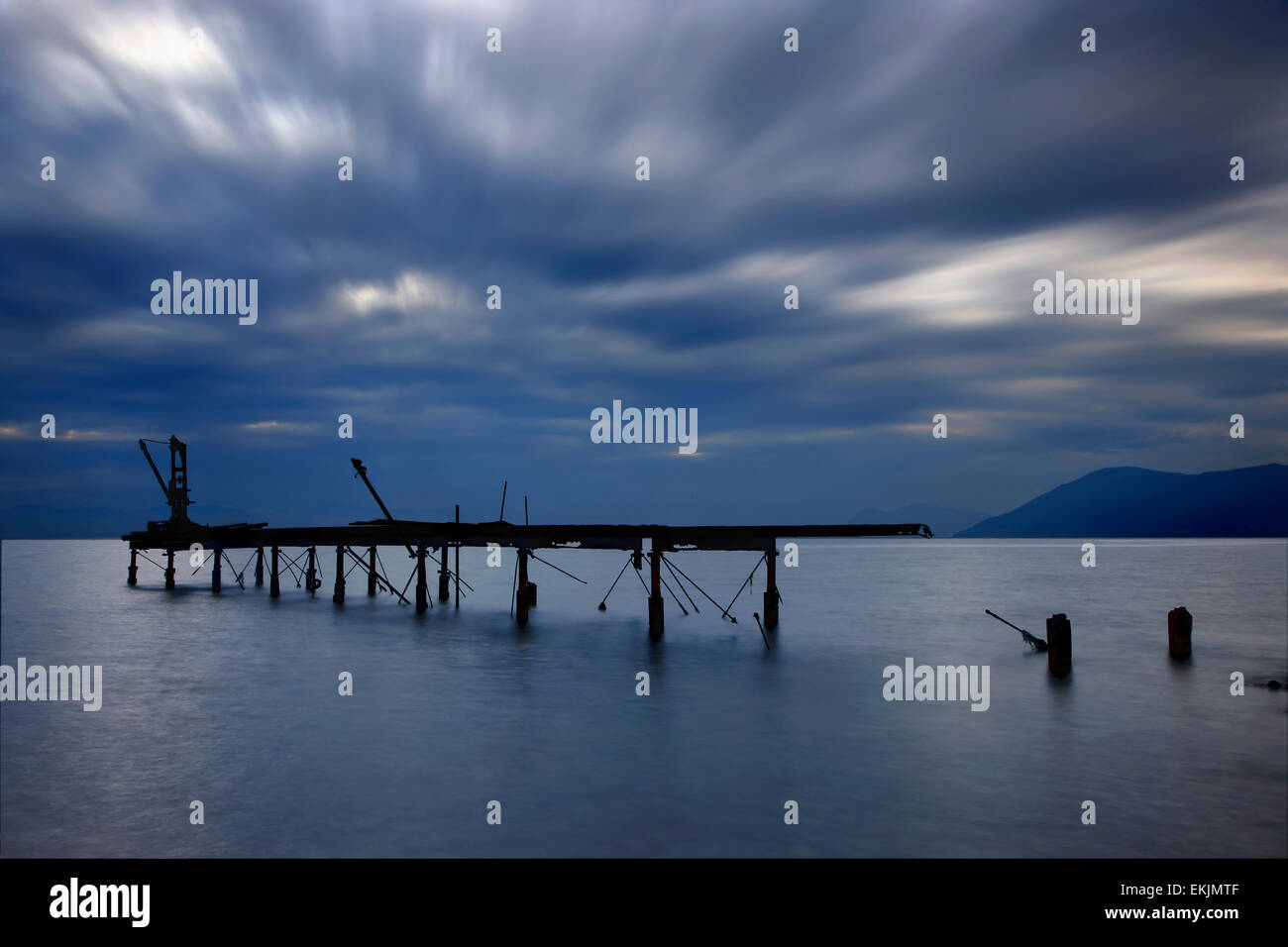 Rusted, destroyed loading pier of an old, abandoned paper factory at Rovies village, North Evia ('Euboea') - Stock Image
